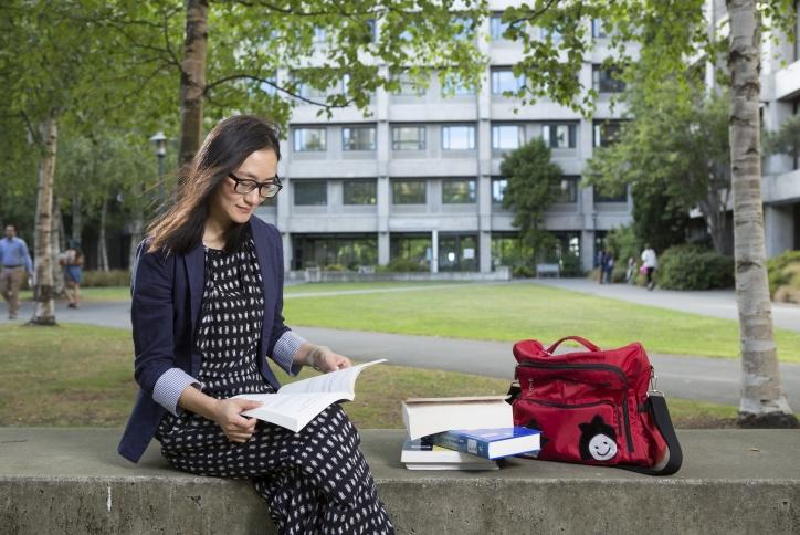 lady sitting outside reading