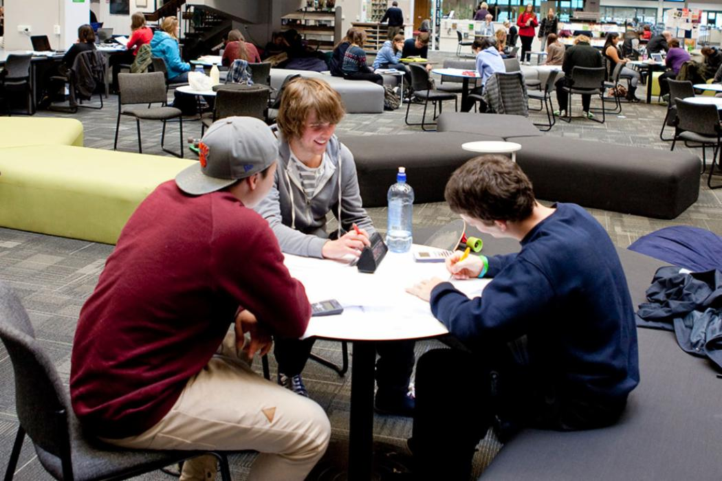 Students studying in library ground floor landscape
