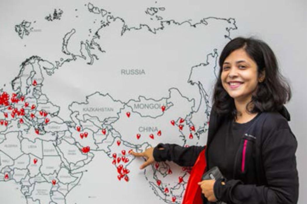 who can help image girl in front of world map