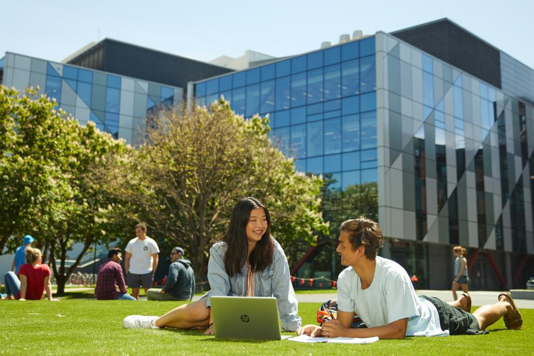 Campus students chatting on grass