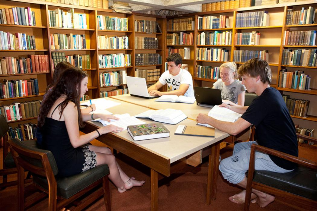 College house hall library students studying small table landscape