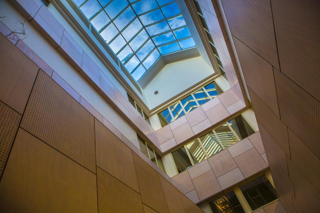Inside law building looking up at the glass ceiling