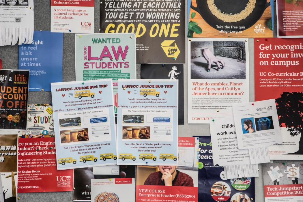 Bulletin board covered in law posters and events