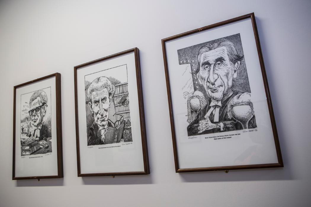 Photos of caricatures of famous NZ lawyers