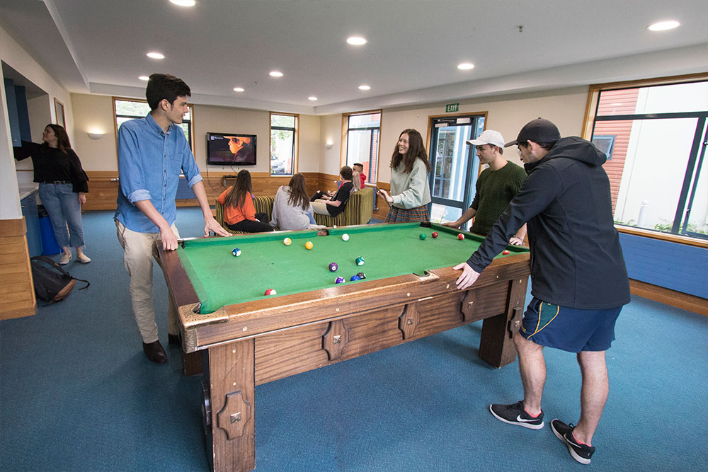 University Hall students playing pool