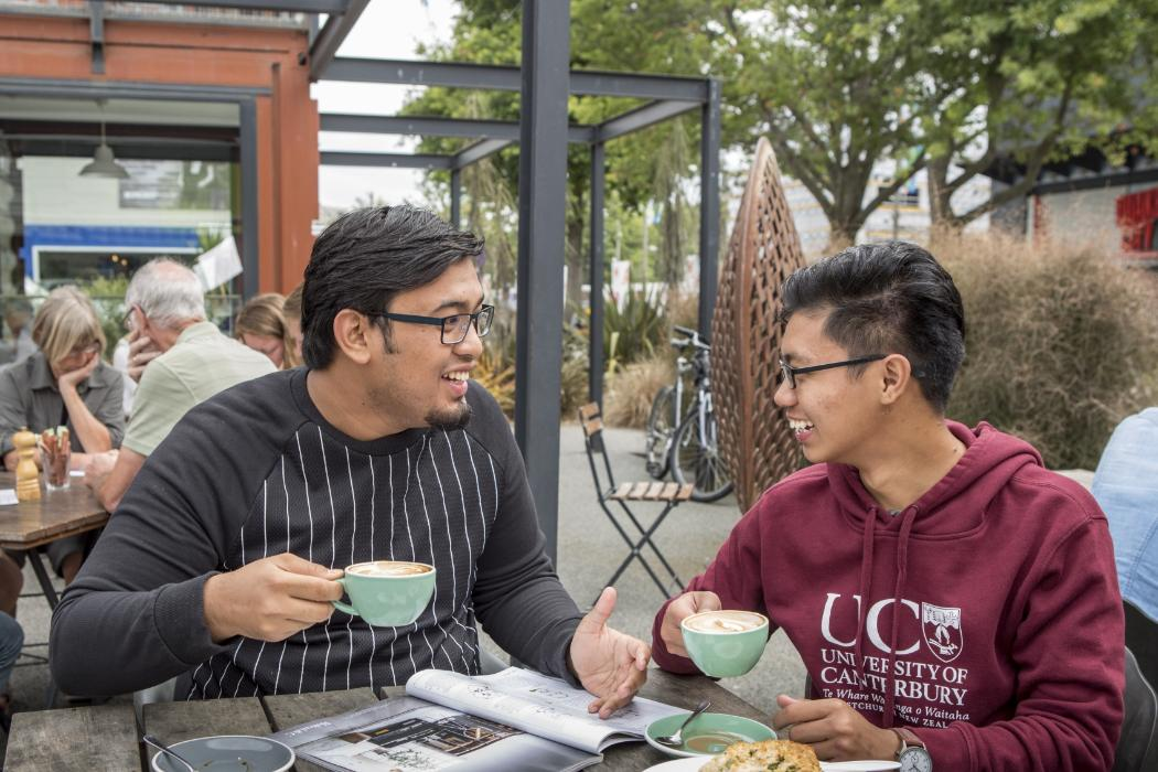student getting mentoring at a cafe