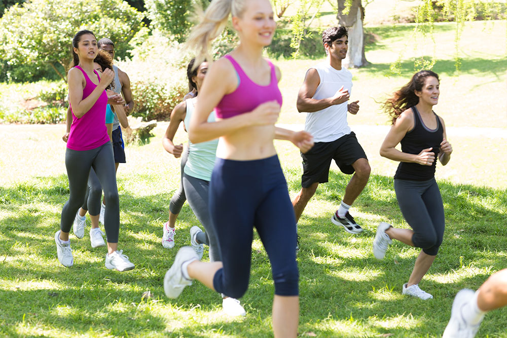 Athletes running on grassy land Depositphotos 42922991
