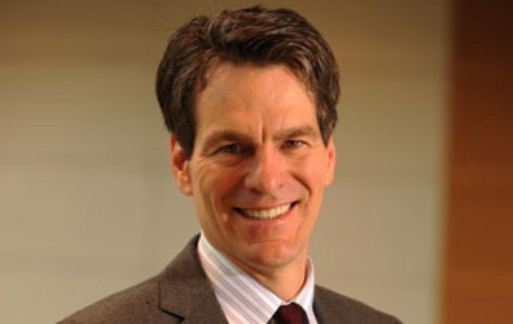 US finance expert giving lecture on govt debt