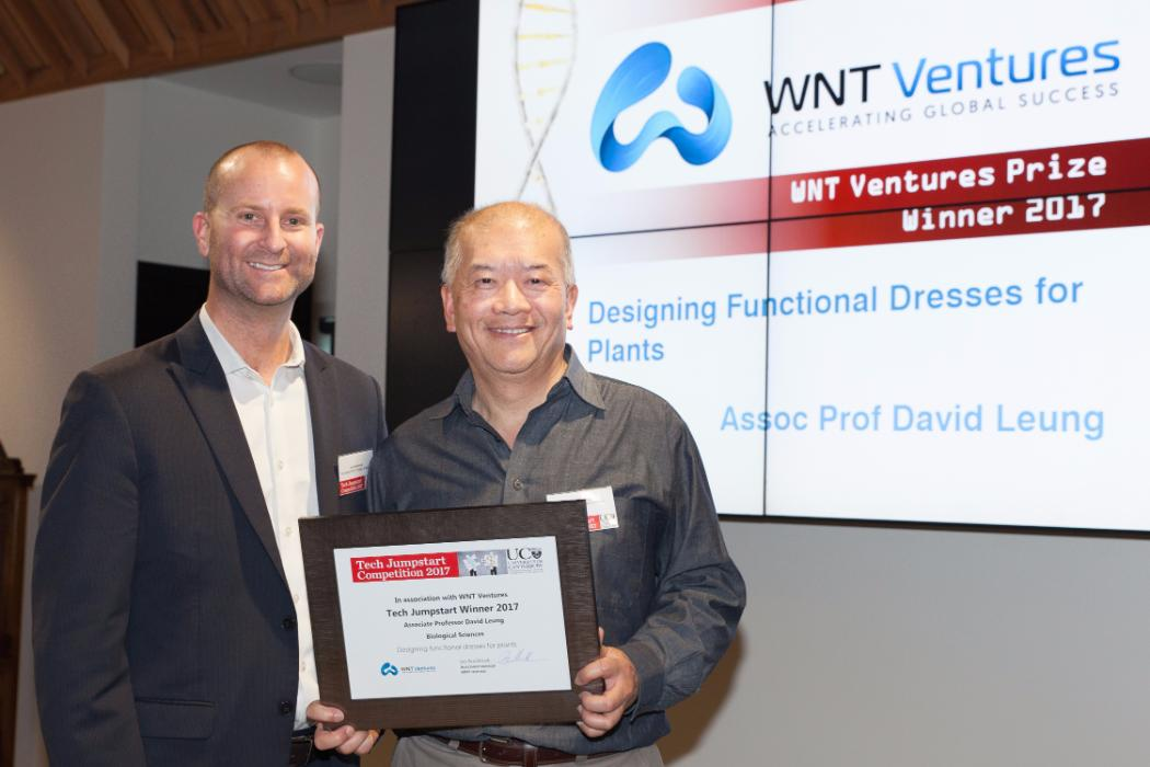 WNT Ventures prize, presented by WNT Ventures' Investment Manager Jon Sandbrook (left), went to Associate Professor David Leung for his botanic environmental management system for protecting plants from pests, infection and bad weather.