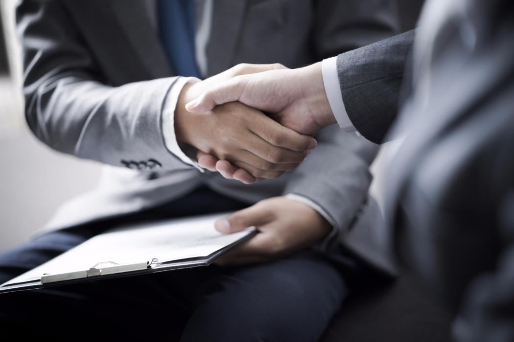 businessman shaking hands to seal a deal with his partner   Shutterstock 594729779