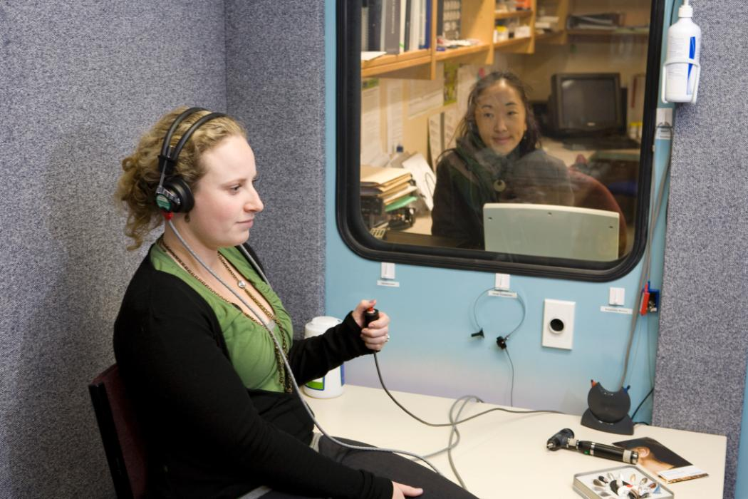 Woman sitting in testing booth