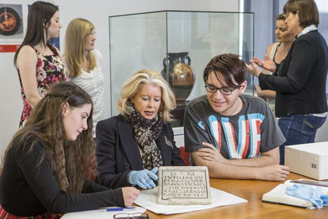 Lecturer showing Logie Collection artifact to Classics students