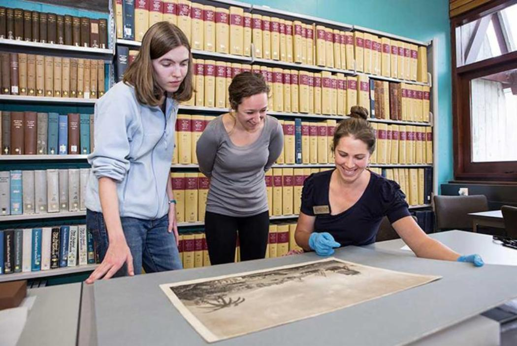 Students looking at historic manuscripts
