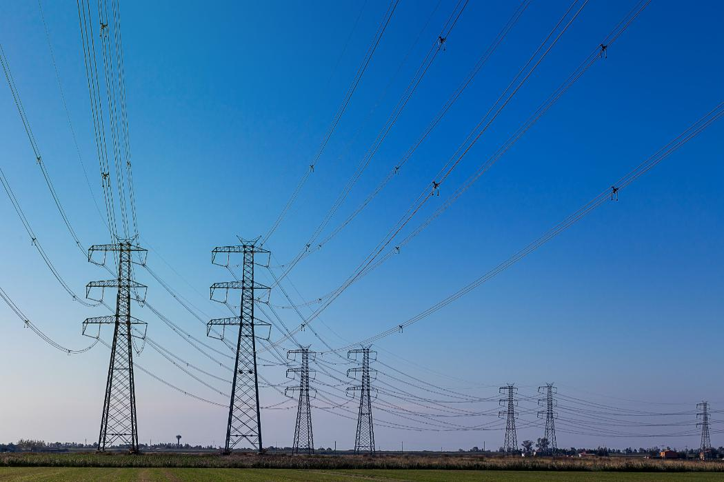 electric pylons on flat grasslands