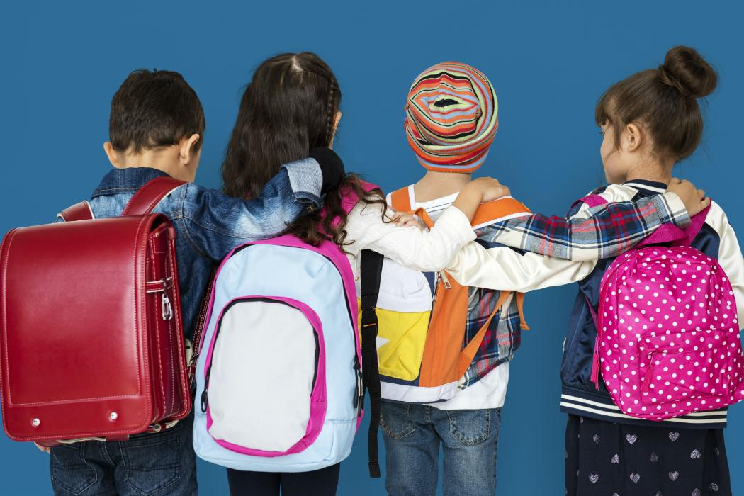 learning and behaviour kids wearing backpacks