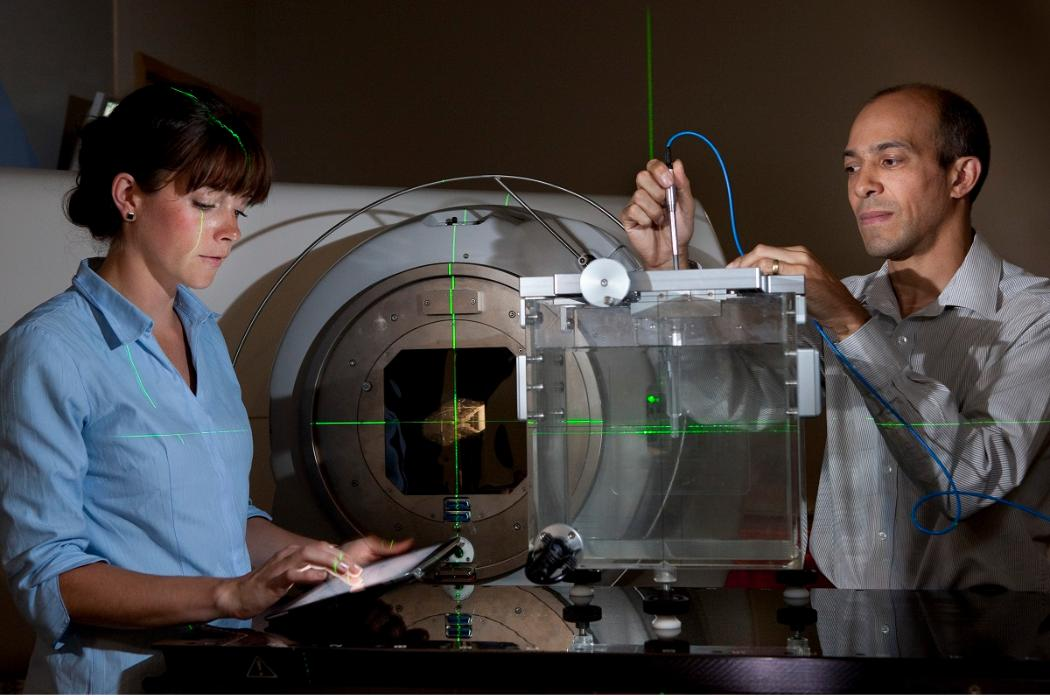 medical physics woman and man with lasers