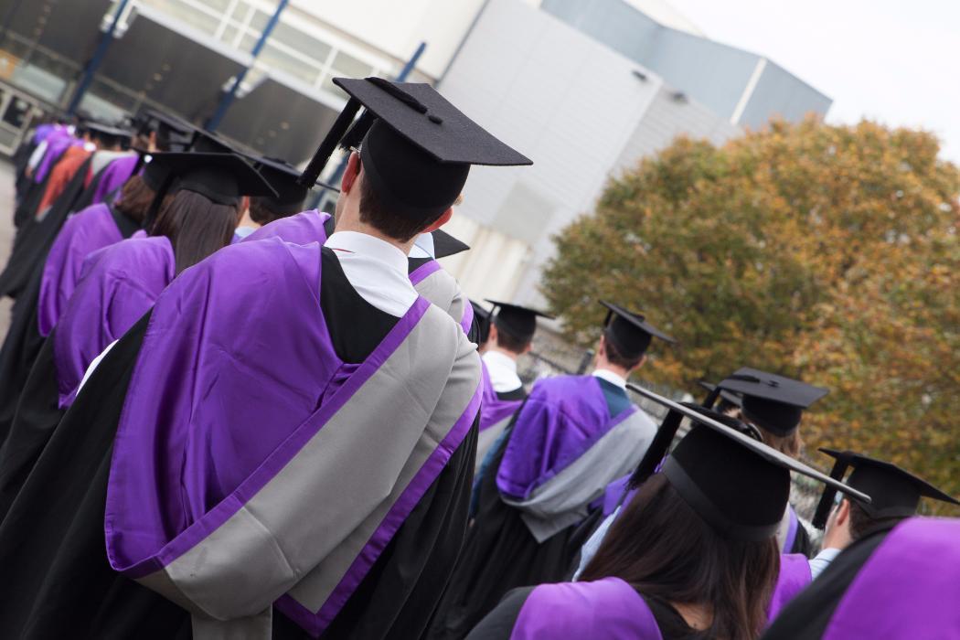 Students graduating in purple engineering robes