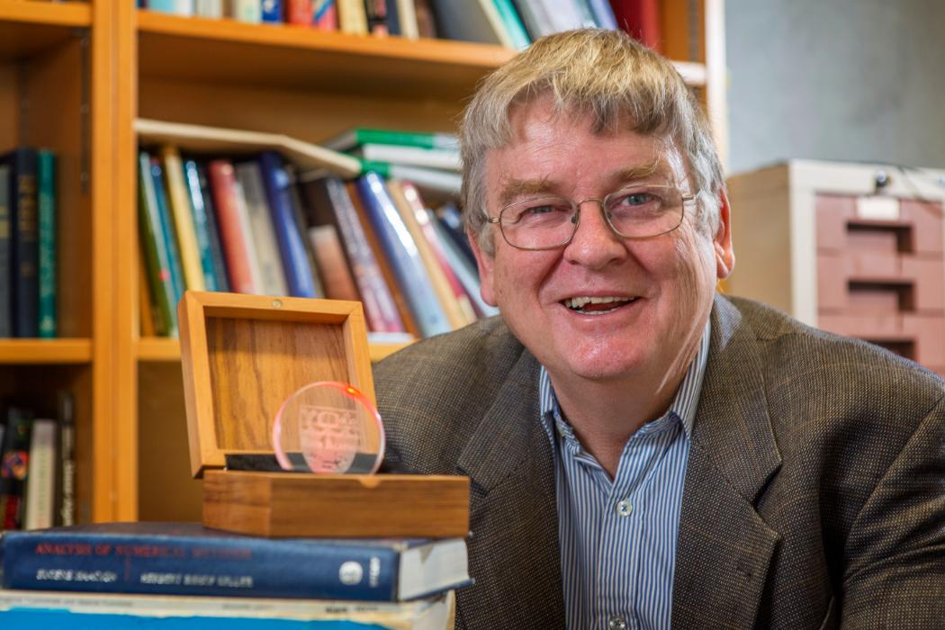 Rick Beatson with his innovation medal