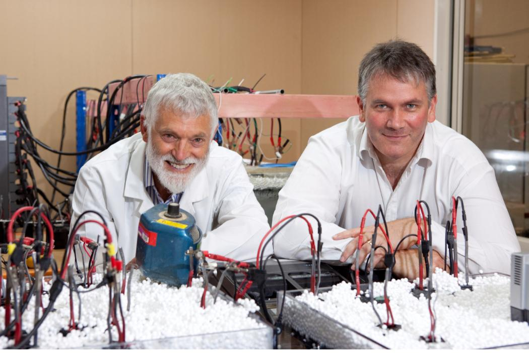 John Abrahamson and Stuart McKenzie in front of Arc battery technology