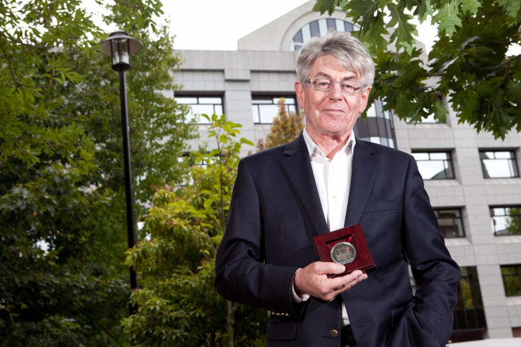 Philip Joseph holding his research medal