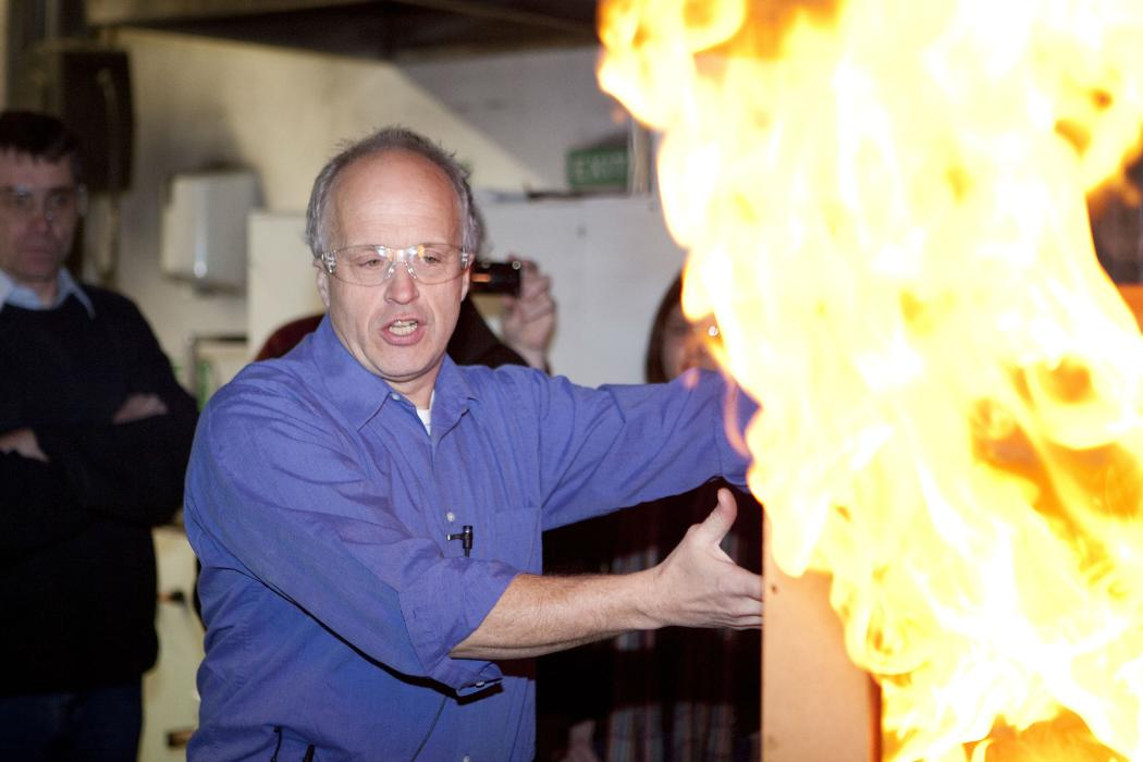 Man does fire demonstration for fire engineering course