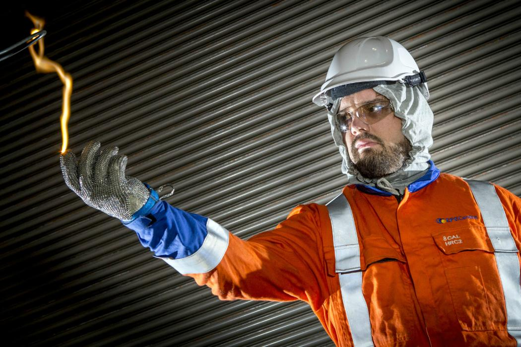 Man in safety gear demonstrates electrical arching