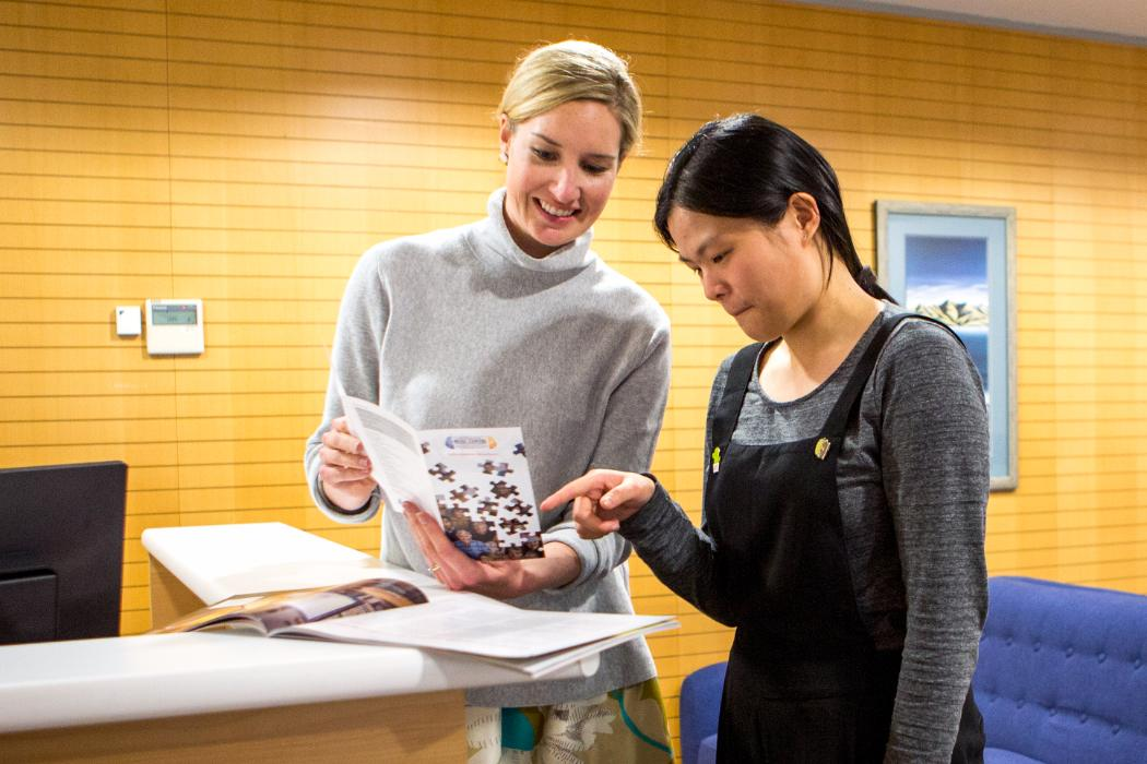Two women looking at brochure