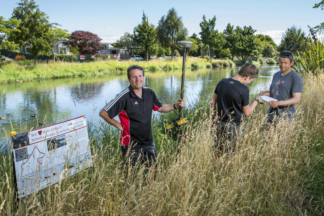 Dr Mike Hickford (left), his son Blake and doctoral researcher Shane Orchard on the banks of the Ōpāwaho Heathcote River.