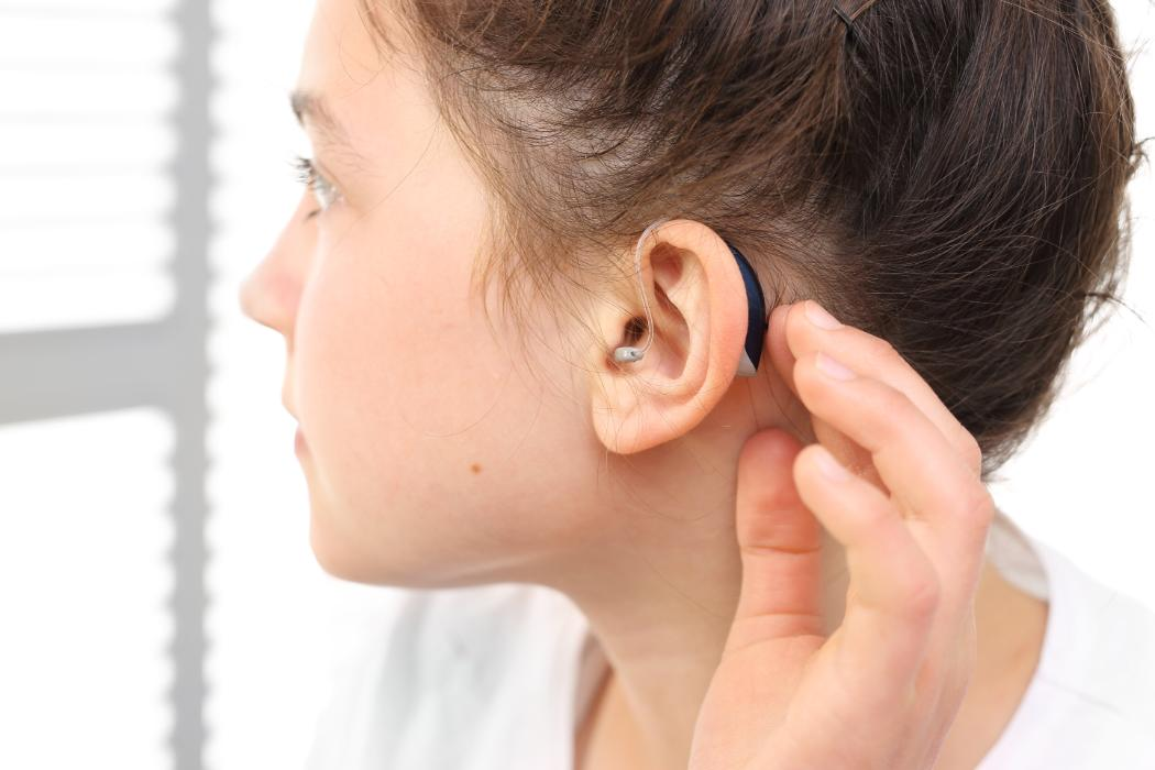 Child with hearing aide