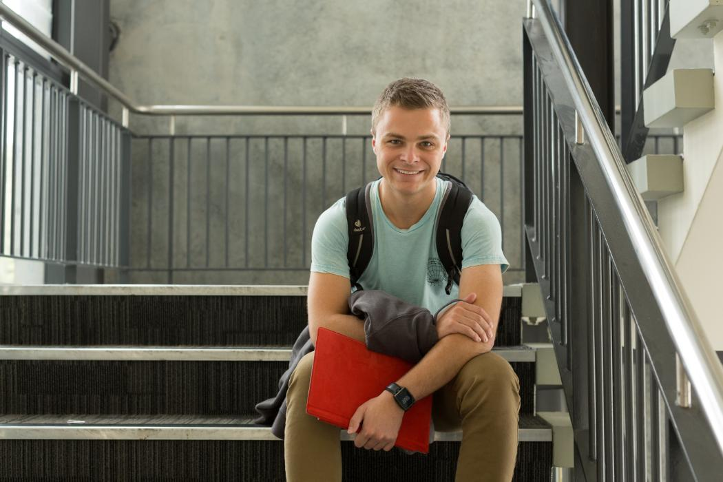 Science Student sitting at stairwell