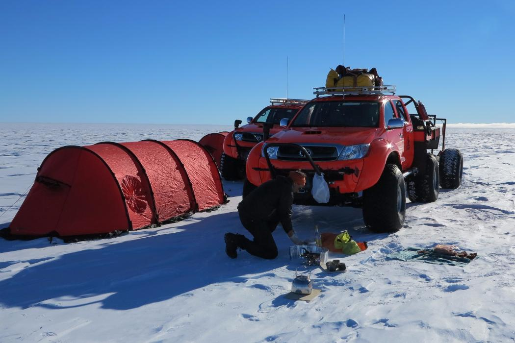 truck and tent on ice in antarctica
