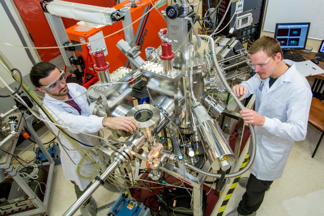 physics students working on machinery