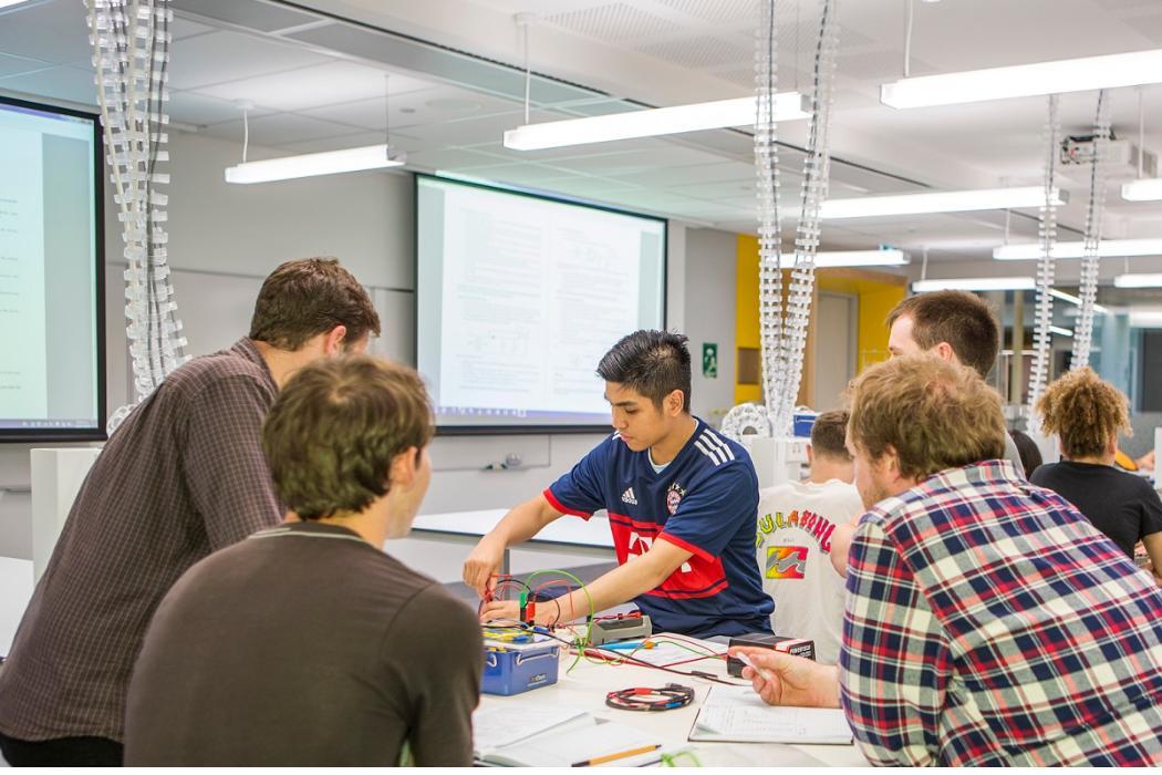 undergraduate physics students in rrsic lab