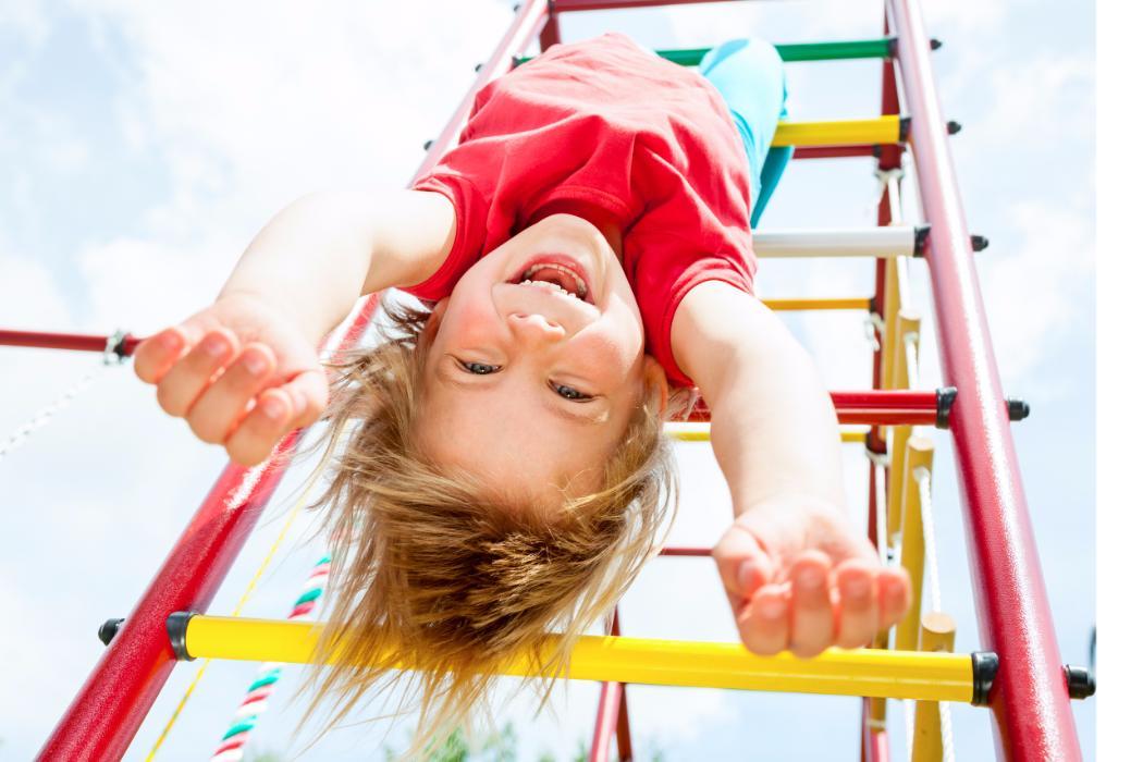 girl having fun on playground equipment