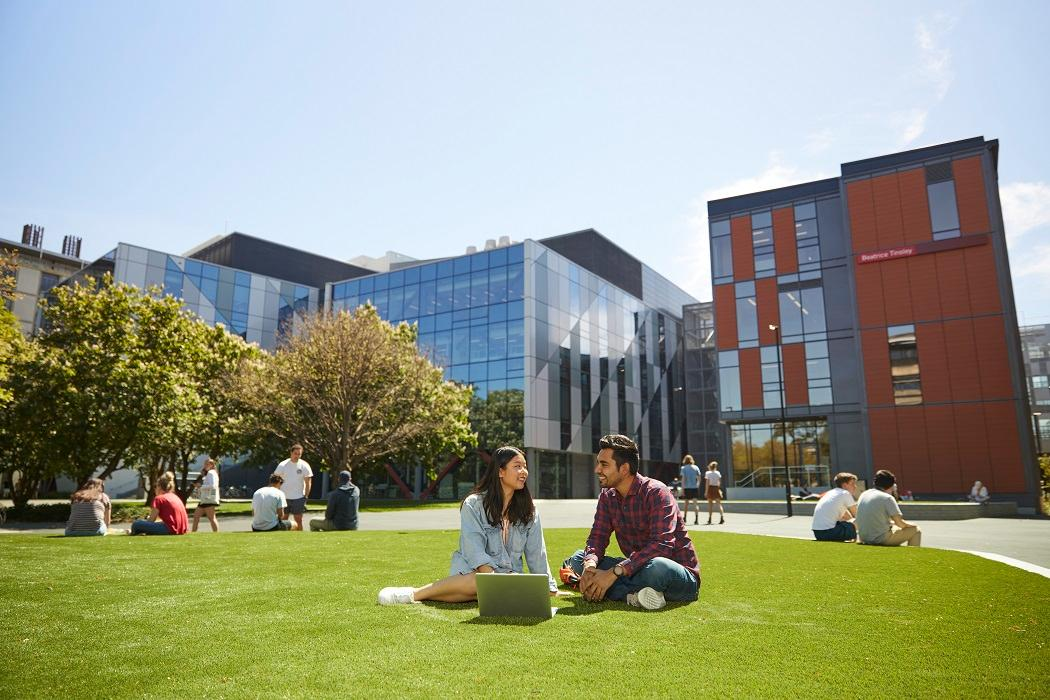 students sitting in the sun outside rrsic