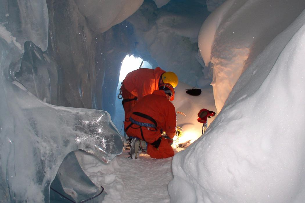 two researchers in ice cave