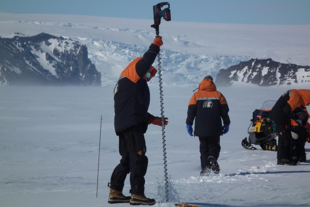 researchers on the ice in Antarctica