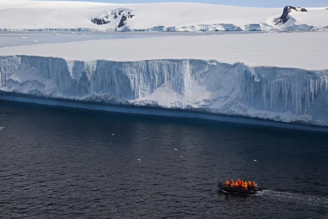boatload of researchers near iceberg