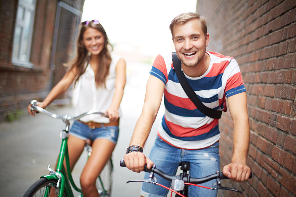 Joyful bicyclists Depositphotos 29875037