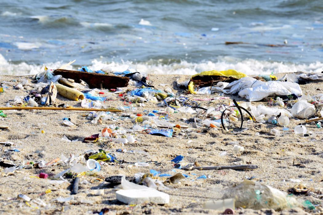 Pollution and plastic on a beach, Environmental science
