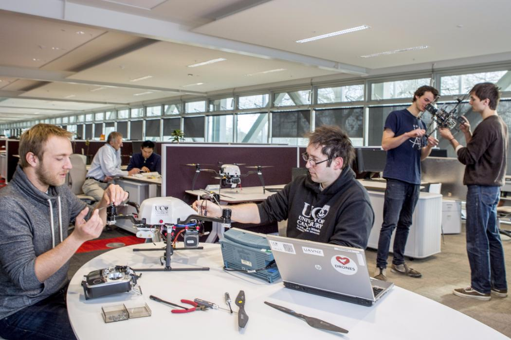 Postgrads with laptop working on drones