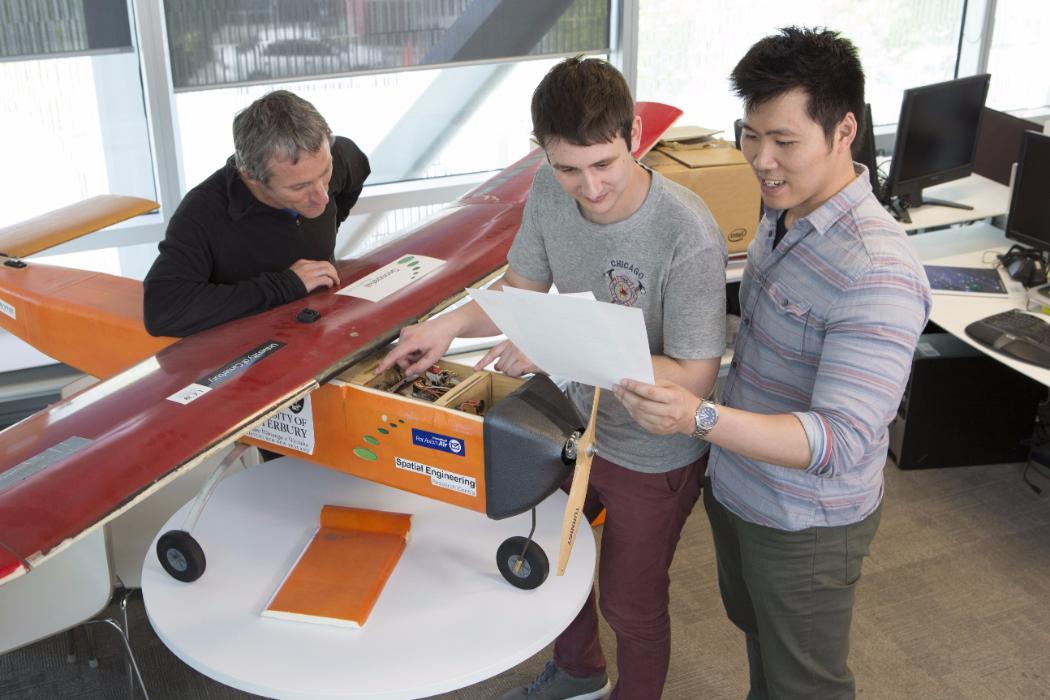 Postgrads and staff working on UAV plane