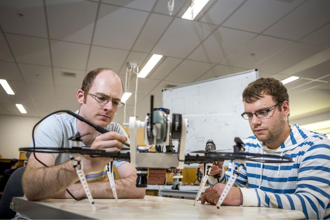 Mechatronics students with equipment