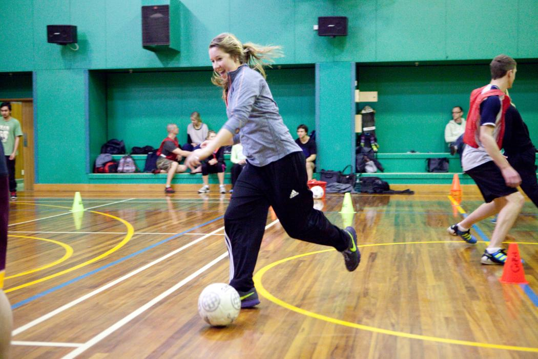 Girl playing indoor soccer