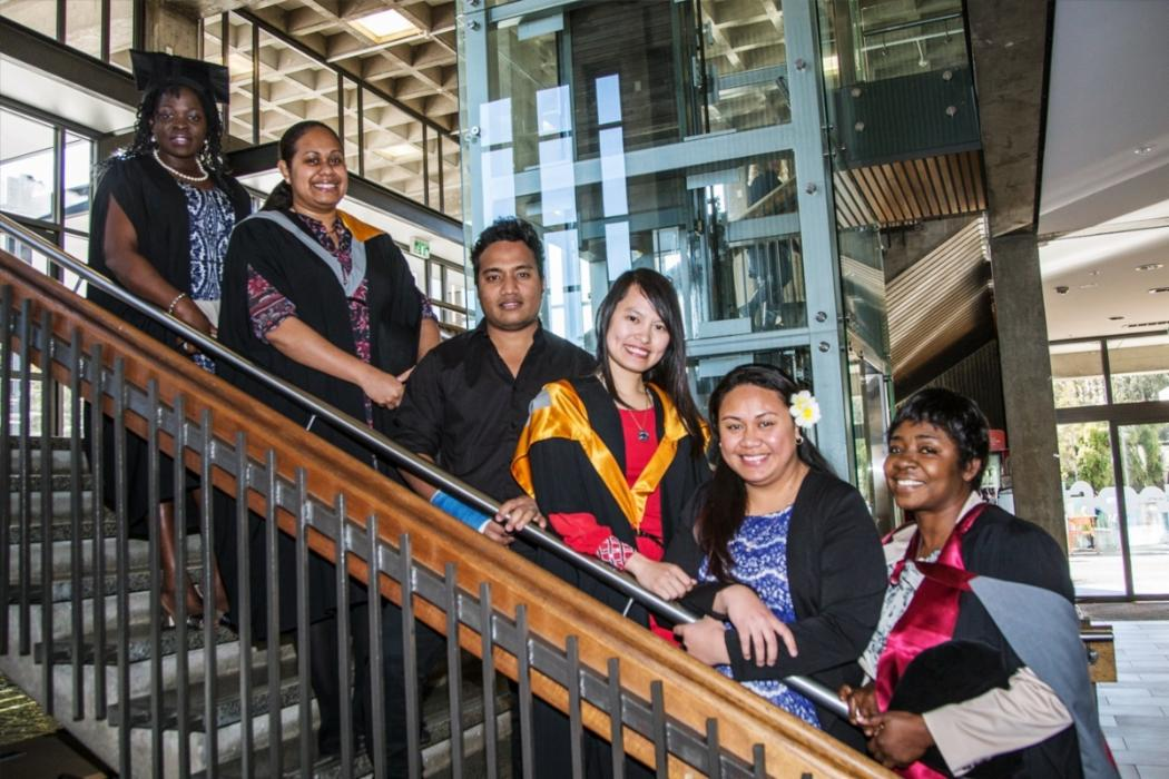 NZ Aid students on library steps on the day of graduation
