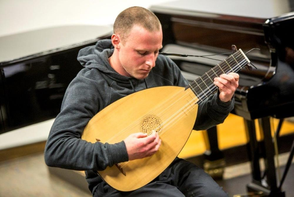A music student playing the lute
