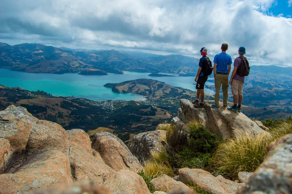 3 students looking down from the top of a cliff Chris Calhun Akaroa