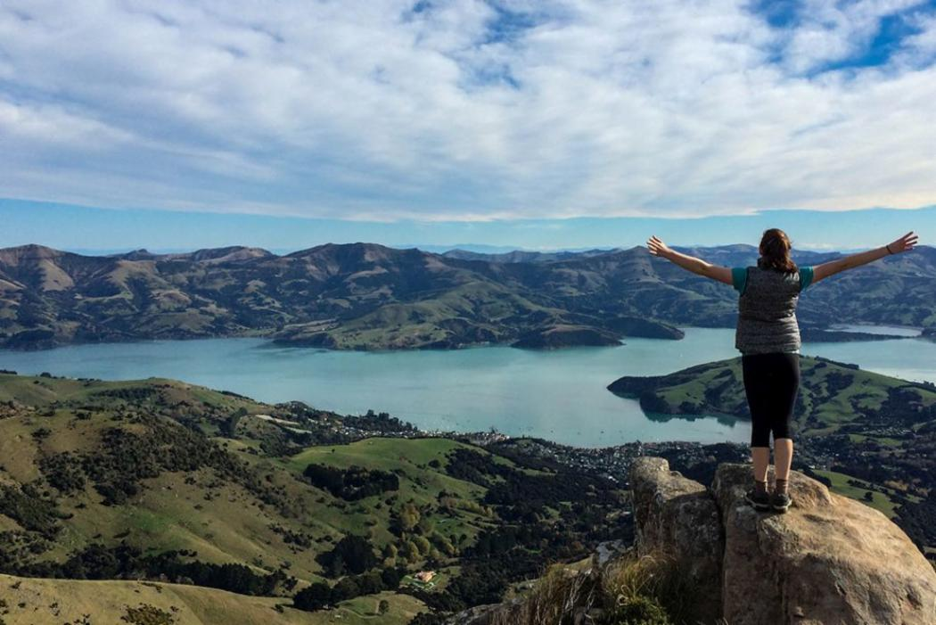 woman standing on rock overlooking Banks Peninsula