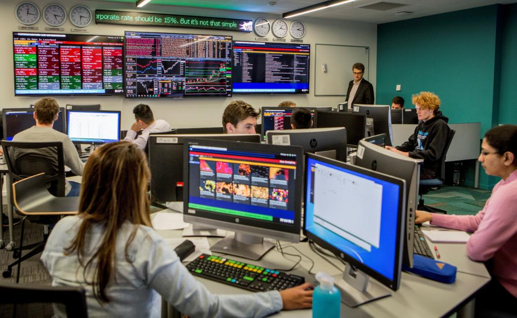 Students learning in the stock exchange room