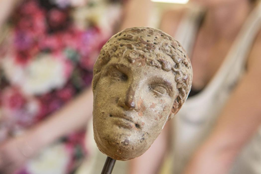 Close up of a small statue head from the Logie Collection